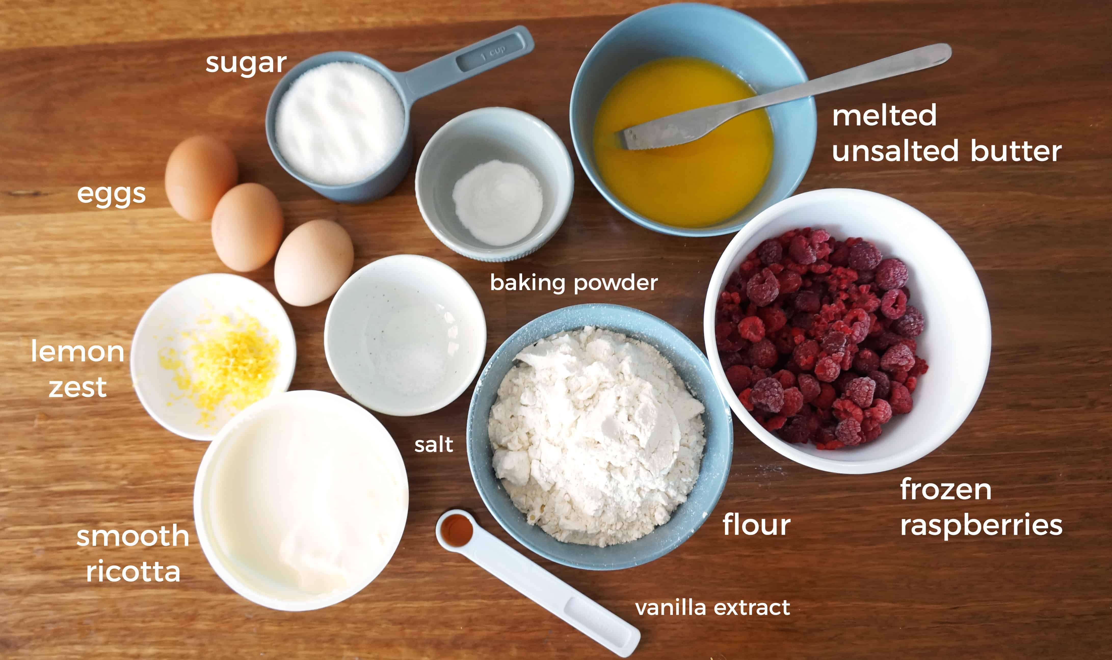 Ingredients for raspberry ricotta cake on a bench