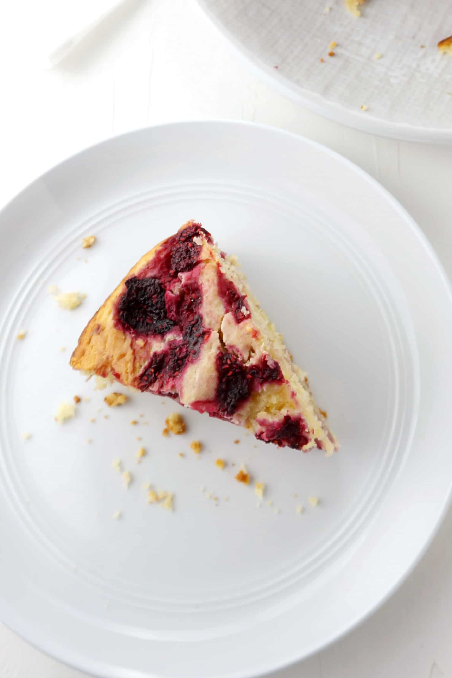 slice of raspberry ricotta cake on a plate