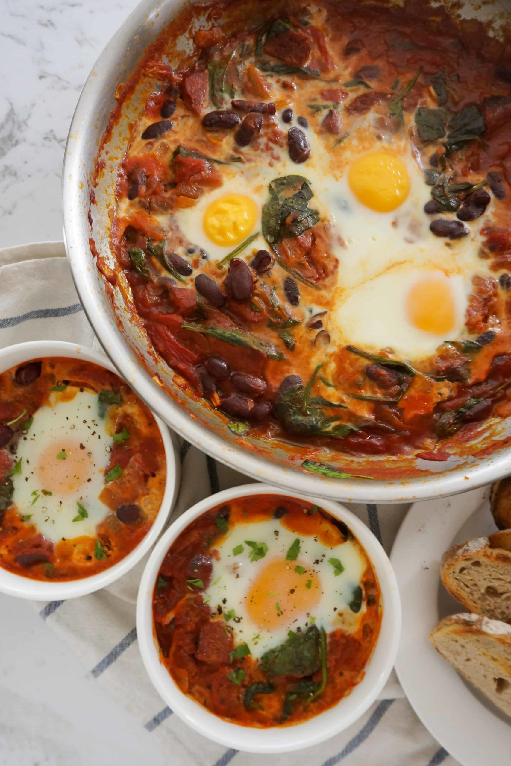 cooked baked eggs in ramekins and in a pan