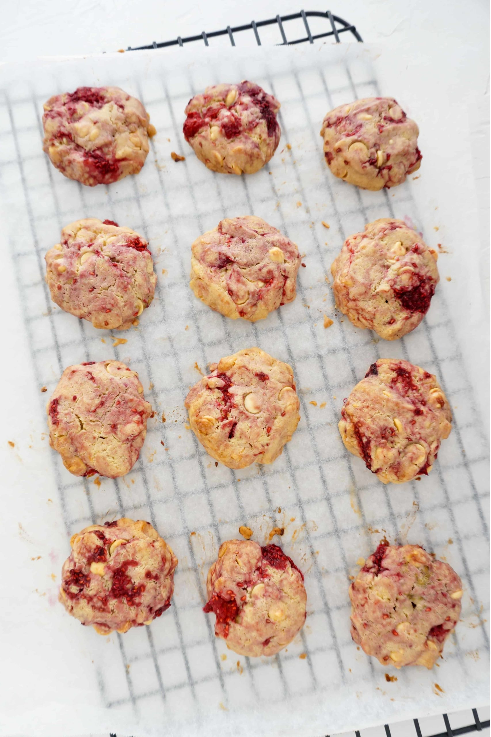 cookies on parchment paper over a cooling rack